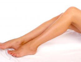 Beautiful woman legs. Isolated over white background